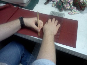 jack tracing and cutting the fabric for the Alien dolls